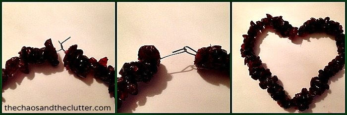 attaching cranberry ornaments