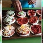kids making mini pita pizzas