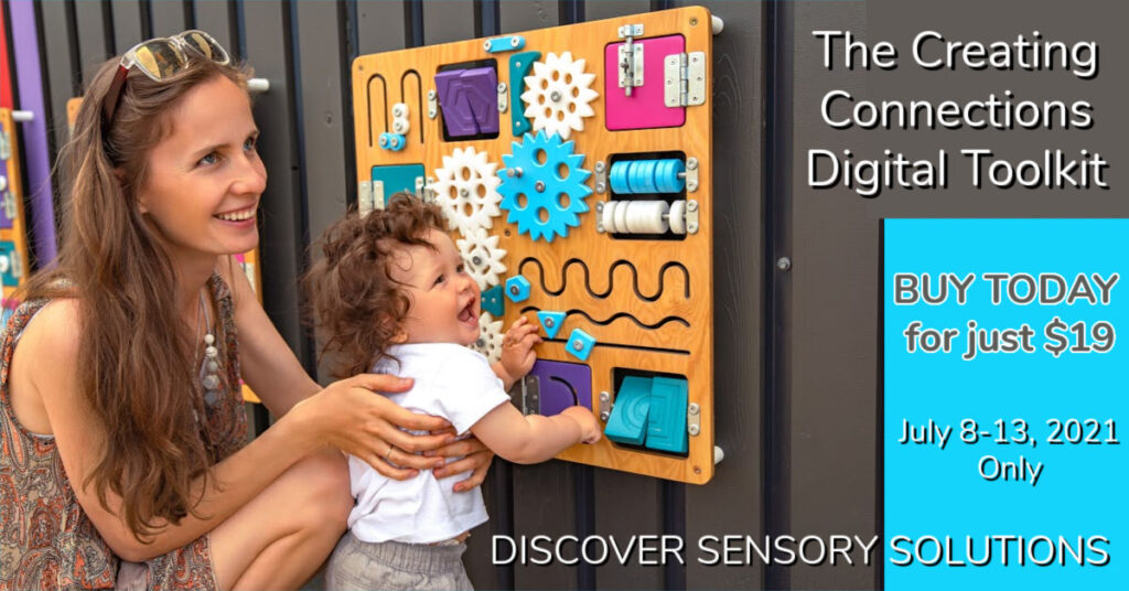a mom helps her young child play with a sensory wall