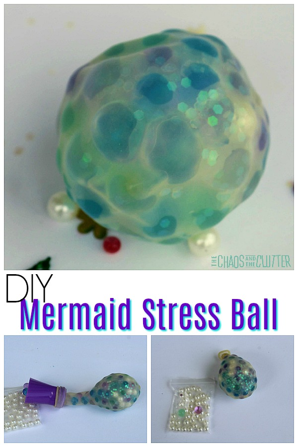 "An opaque ball contains green, blue, and clear balls and sits on a white background with confetti sprinkled on it. The words ""DIY Mermaid Stress Ball"" are in the middle. Below, there is a balloon attached to a small purple funnel and the filled balloon next to a small bag of white faux pearls."
