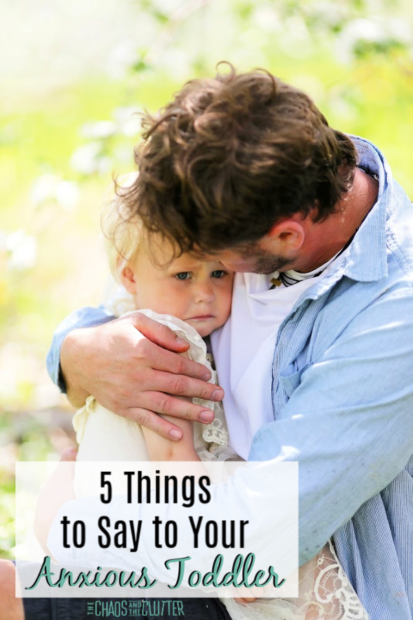 "a brown haired father is holding his blond daughter. The text reads ""5 Things to Say to Your Anxious Toddler"""