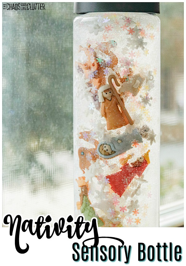 "clear bottle filled with clear liquid, falling snow, and the nativity icons with text that reads ""Nativity Sensory Bottle"""