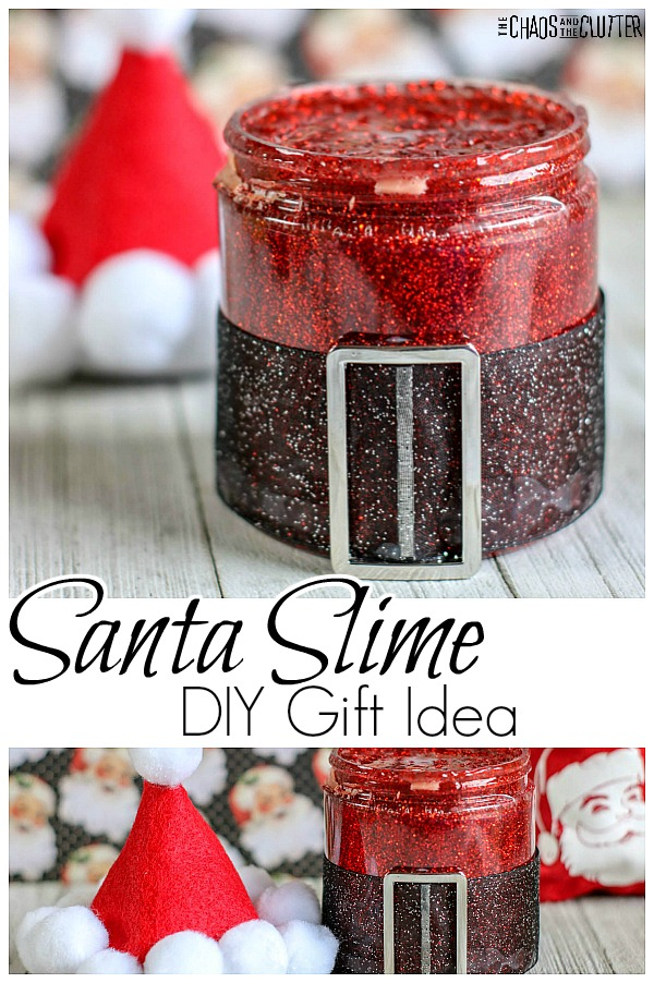 "jar with a Santa belt filled with red glitter slime with a tiny homemade Santa hat in the background with text that reads ""Santa Slime DIY Gift Idea"""