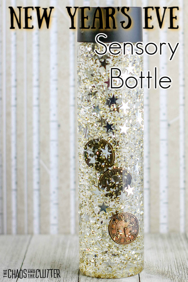 "clear bottle with liquid, glitter, confetti, and mini clocks with text that reads ""New Year's Eve Sensory Bottle"""