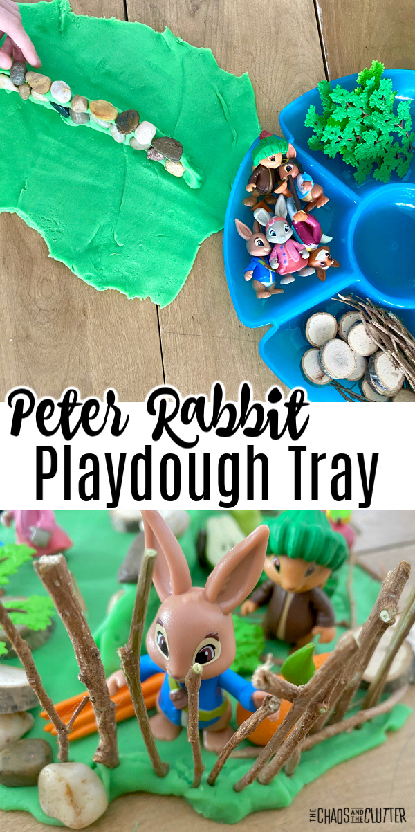 "blue tray with rocks, twigs, wood slices, green playdough. Text reads ""Peter Rabbit Playdough Tray"""