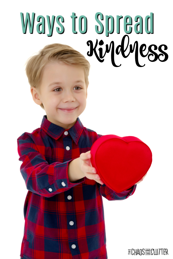"young blond boy holds a plush heart with text that reads ""Ways to Spread Kindness"""