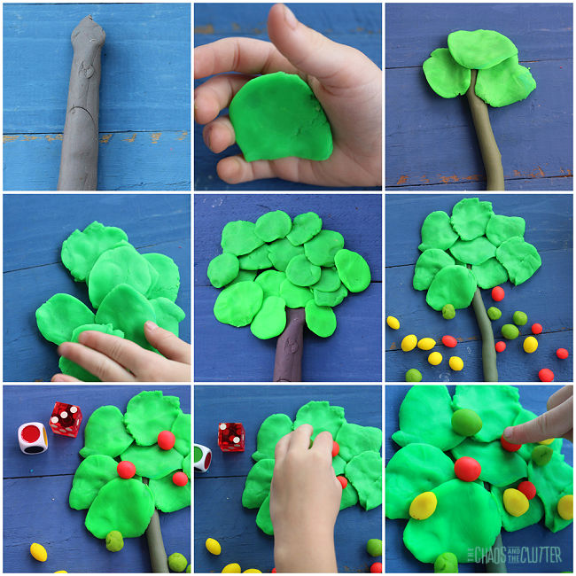 playdough is shaped into a tree and then small playdough balls for apples are placed on the tree