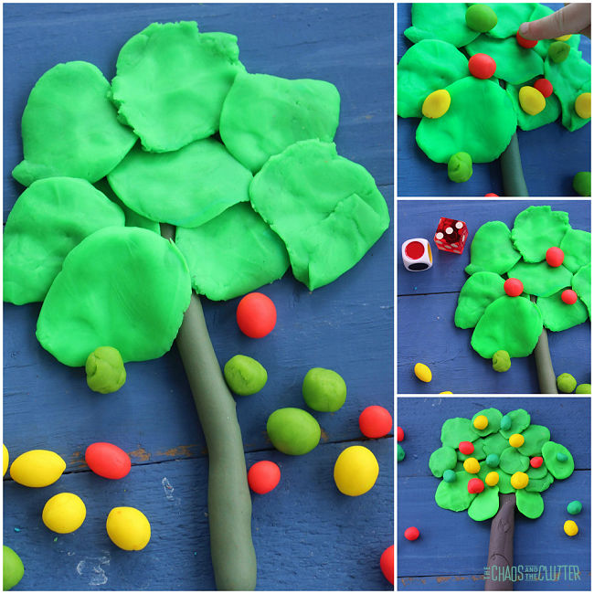 playdough is shaped to make a tree and balls of apples