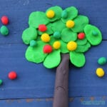 apple tree made out of playdough on a blue background