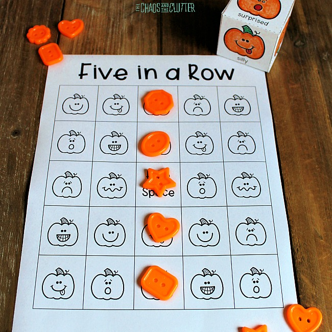 paper with pumpkin pictures and orange buttons set on top