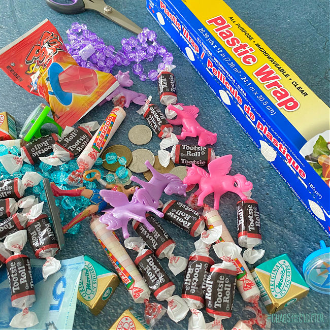 treats and candy strewn on a table