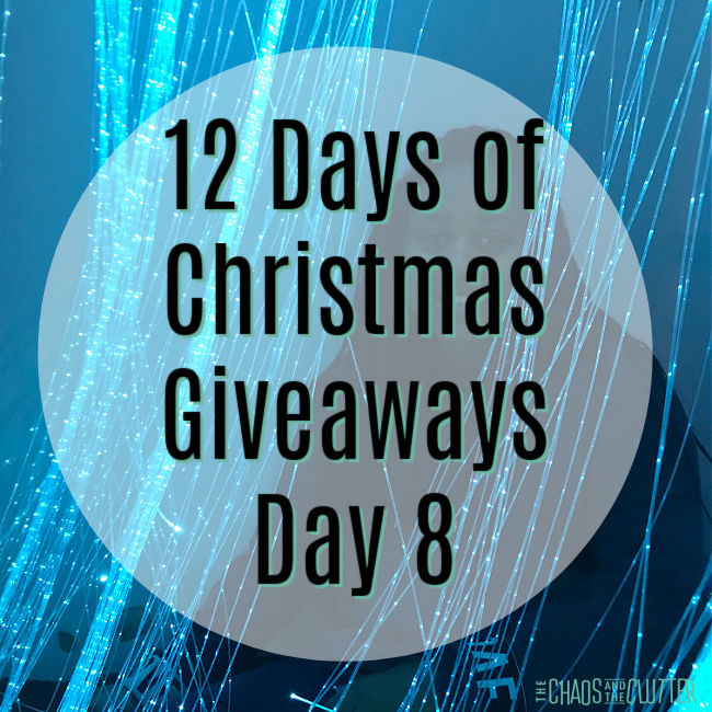 "circle overlay on a photo of blue string lights. Text reads ""12 Days of Christmas Giveaways Day 8"""
