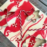 red and white swirls in a dish with candy canes and cookie cutters
