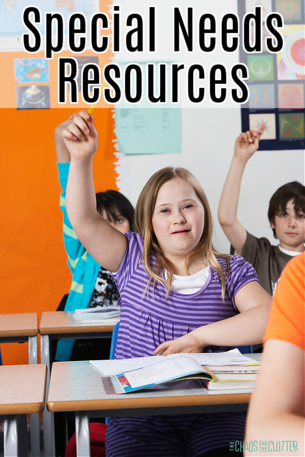 girl in striped purple shirt sitting at her desk in class has her hand raised