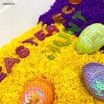 yellow and purple with toy sparkly eggs and the letters to spell Easter Egg Hunt