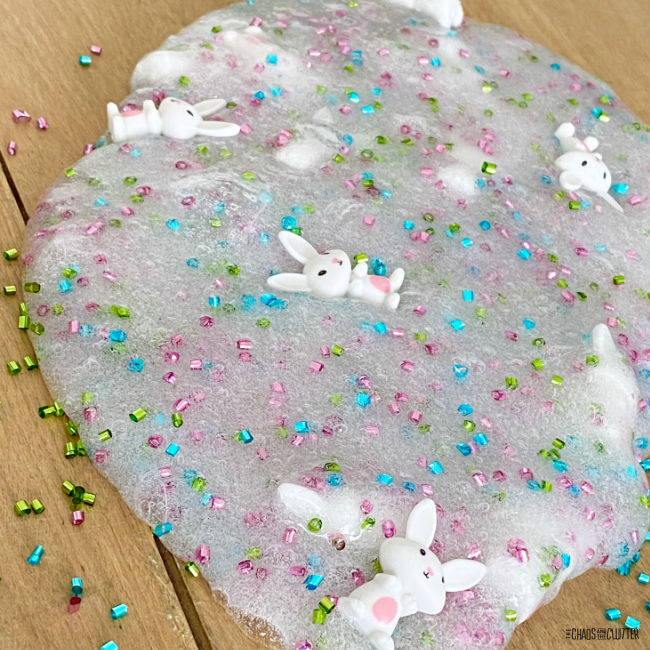 slime that has coloured mini beads and small bunny toys in it