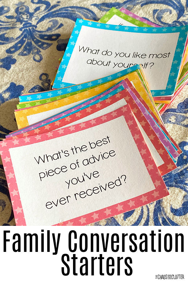brightly coloured cards spread out on a tablecloth